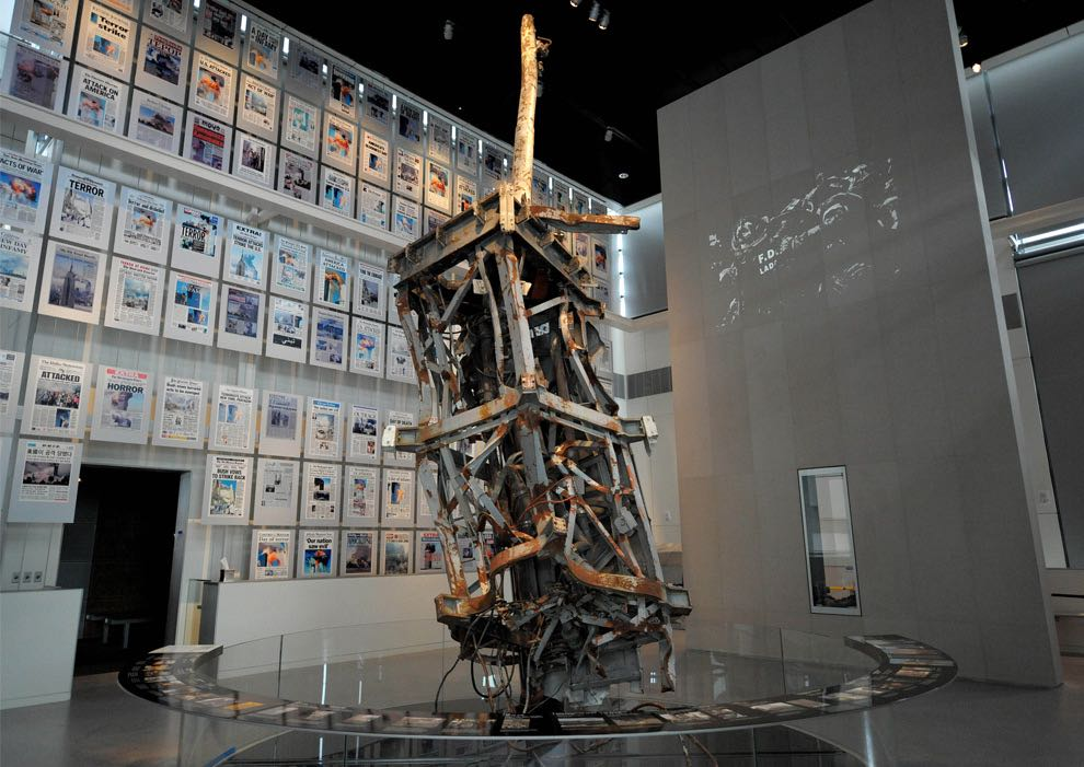 The mangled TV antenna from the World Trade Center with a wall of the days front pages from around the world at Newseum in Washington, D.C.