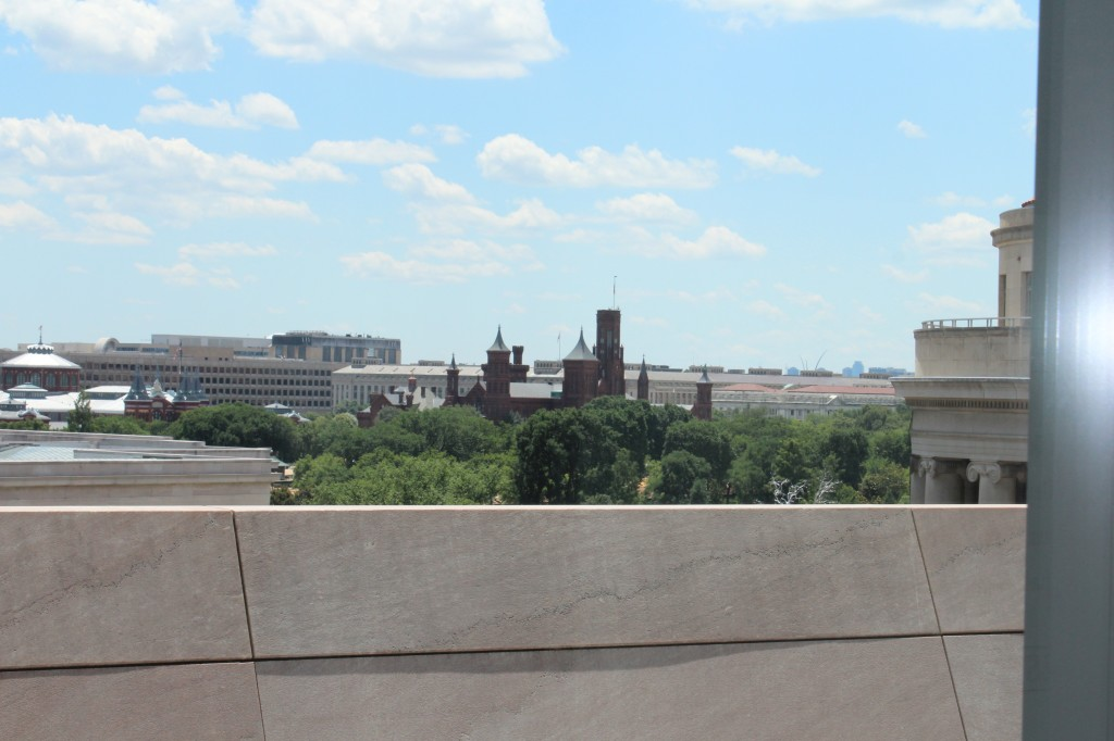 The Newseum's Pennsylvania Avenue Terrace view from the 7th floor, you can see the Smithsonian Mansion (in dark brick)