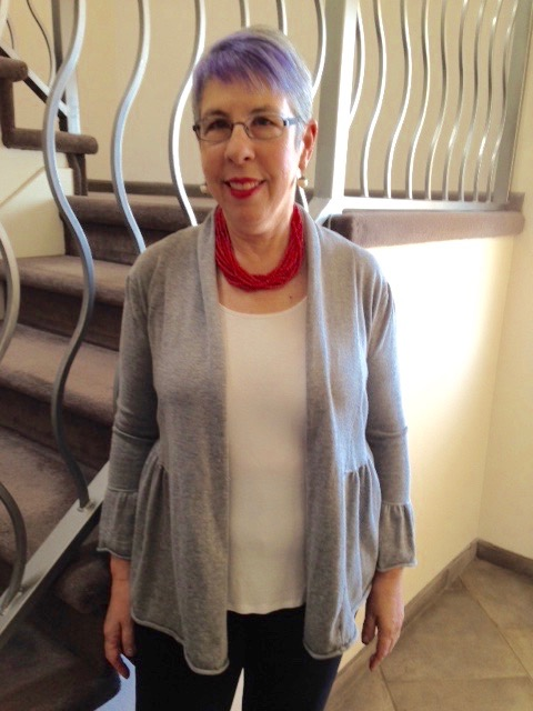 Lady in Red, Nina Forrest wearing her original jewelry design.